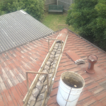 Removal of ridge tiles (bedding rig in place) ready for re-bedding